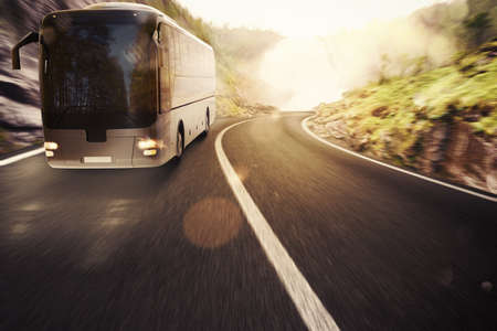 Bus driving on road with landscape background