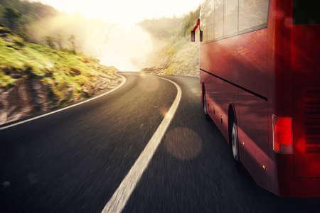 Photo pour Bus driving on road with landscape background - image libre de droit
