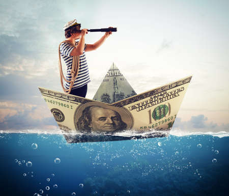 Sailor with binoculars on big banknote boat