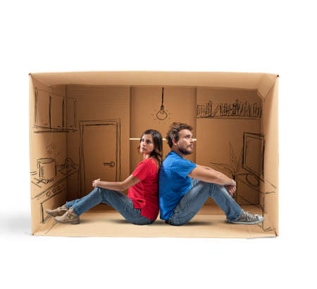 Couple in a house designed in cardboard