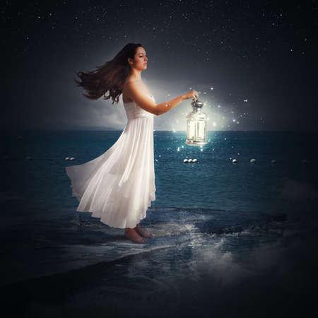 Woman walks at night with a lantern