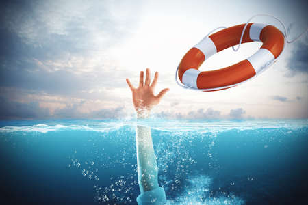 Foto per Lifesaver launched a drowning man in the sea - Immagine Royalty Free