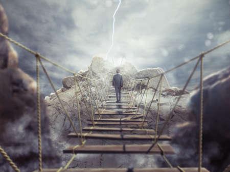 Photo pour 3D Rendering of man walks over a crumbling bridge - image libre de droit