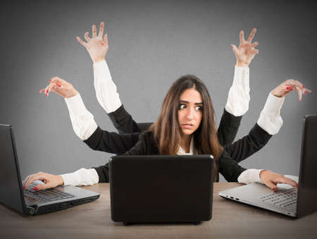 Photo pour Woman with many arms working with three laptops - image libre de droit