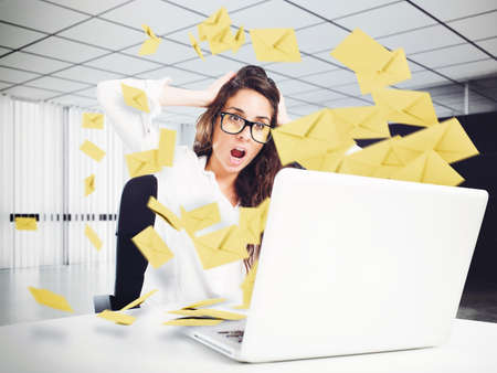 Photo for Desperate woman in office for too many e-mail - Royalty Free Image