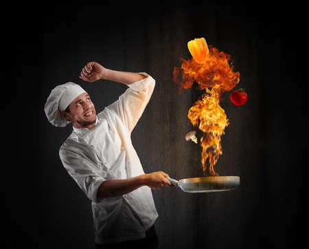 Photo pour Cook chef with a big explosion in kitchen - image libre de droit