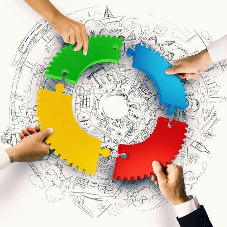Foto de Business people join the colorful puzzle pieces of gear. Concept of integration. 3D Rendering - Imagen libre de derechos