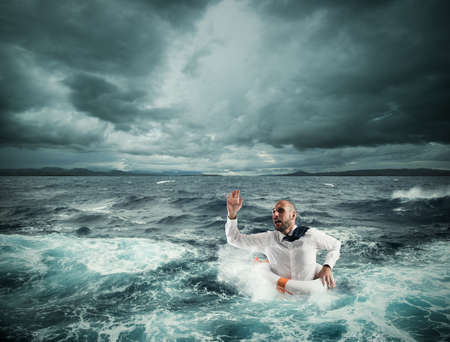 Photo for Man with lifesaver for help in a stormy sea - Royalty Free Image