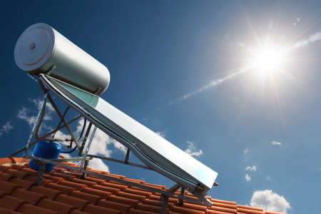 Foto de Solar panel with water tank on the roof of a house - Imagen libre de derechos