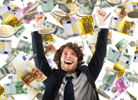 Photo for Happy businessman exults under a rain of coins and banknotes - Royalty Free Image