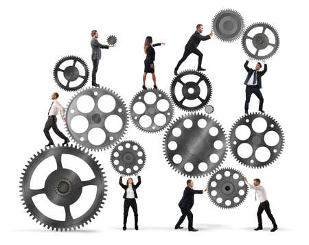 Photo pour Teamwork of businesspeople work together to a system of gears - image libre de droit