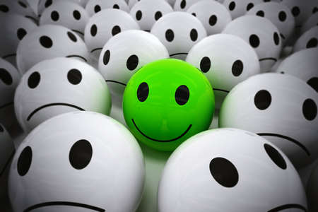 Foto de 3D Rendering green ball with smiley face among so many white sad balls. happy leader supports his negative team - Imagen libre de derechos
