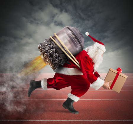 Santa Claus with gift box runs with a missile in a track