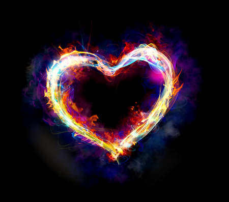 Foto de Heart with colourful light motion and fire on dark background - Imagen libre de derechos