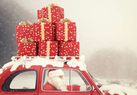 Photo pour Santa Claus drives a red car full of Christmas present - image libre de droit