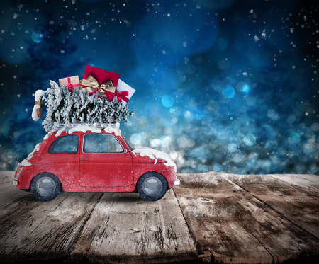 Christmas tree and presents on the roof of a car on wooden floor. Xmas holiday travel concept. 3D rendering