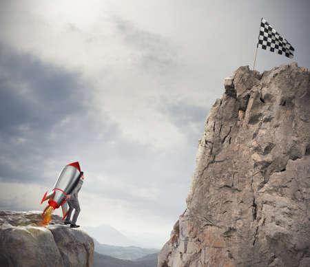 Photo pour Determination and power businessman that holds a rocket to reach the flag - image libre de droit
