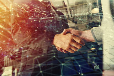 Photo pour Handshaking business person in office with network effect. Concept of teamwork and partnership. Double exposure - image libre de droit