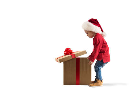Foto de Child that open a magic Christmas gift. White background - Imagen libre de derechos