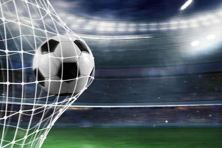 Foto de Soccer ball scores a goal on the net - Imagen libre de derechos