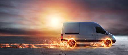 Foto de Super fast delivery of package service with van with wheels on fire - Imagen libre de derechos