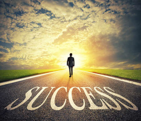 Foto de Man walks on a success way. Concept of successful businessman and company startup - Imagen libre de derechos