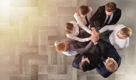 Photo pour Business people putting their hands together. Concept of integration, teamwork and partnership - image libre de droit