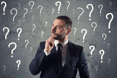 Foto de Confused and pensive businessman worried about the future - Imagen libre de derechos
