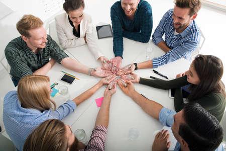 Foto de Teamwork and brainstorming concept with businessmen that share an idea with a lamp. Concept of startup - Imagen libre de derechos