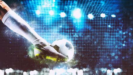 Foto de Football scene at night match with player ready to shoot the ball - Imagen libre de derechos