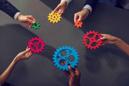 Photo pour Business team connect pieces of gears. Teamwork, partnership and integration concept. - image libre de droit