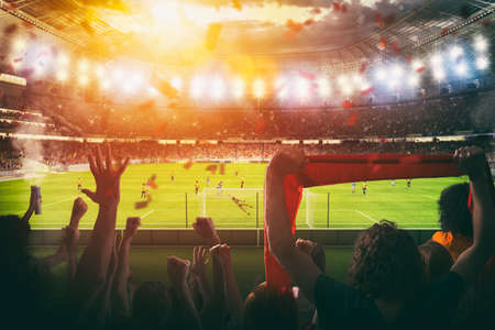 Photo pour Football scene at night match with with cheering fans at the stadium - image libre de droit