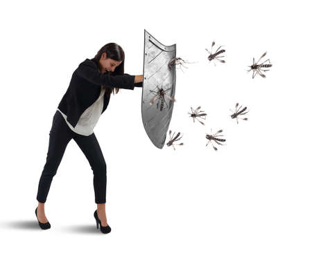 Photo for Woman defends herself from the attack of mosquitoes with a shield - Royalty Free Image