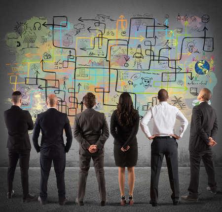 Photo pour Business team drawing a new complex project - image libre de droit
