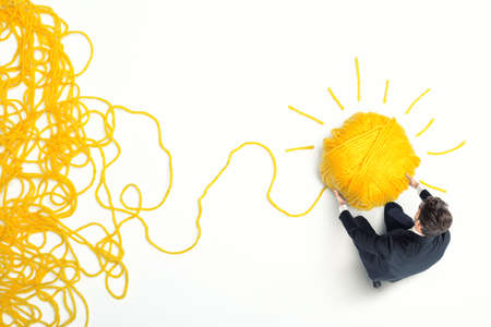 Photo pour Concept of solution and innovation with wool ball - image libre de droit