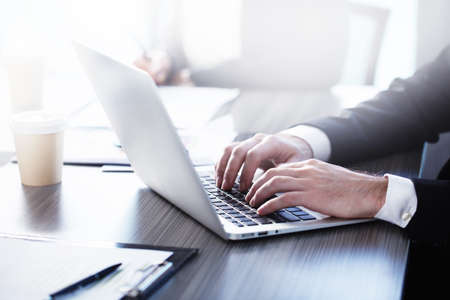 Foto de Man working on a laptop. Concept of internet sharing and interconnection - Imagen libre de derechos