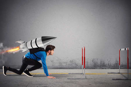 Photo pour Student overcomes obstacles of his studies at top speed with a rocket - image libre de droit