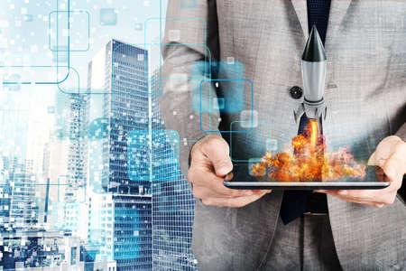 Photo pour Businessman launches rocket from a tablet. concept of company startup - image libre de droit