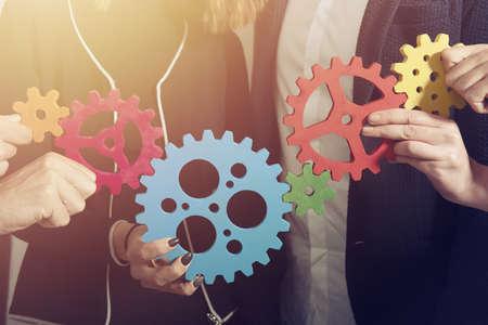 Photo pour Business team connect pieces of gears. Teamwork, partnership and integration concept - image libre de droit