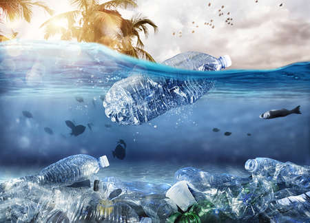 Foto de Floating bottle. Problem of plastic pollution under the sea concept - Imagen libre de derechos