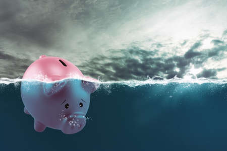 Photo for Lonely piggy bank sails in bad waters due to the crisis - Royalty Free Image