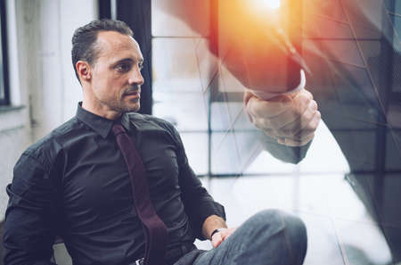 Photo pour Confident businessman during a meeting. He watches far for future business vision. Handshake with partner in overlay - image libre de droit