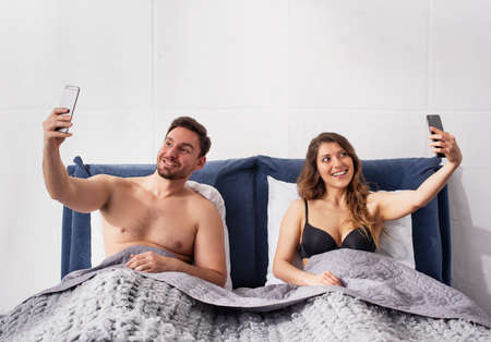 Photo pour Both Girlfriend and boyfriends are chatting with others. Infidelity concept - image libre de droit