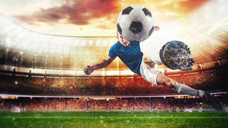 Photo for Football scene with a player who kicks the ball on the fly at the stadium - Royalty Free Image