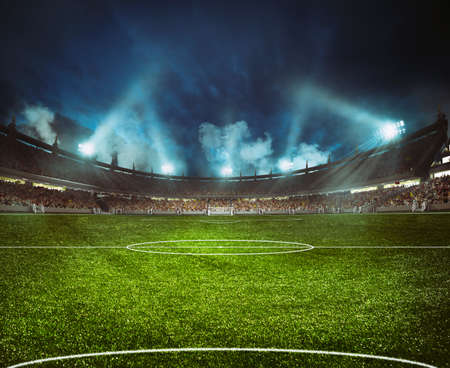 Photo pour Football stadium with the stands full of fans waiting for the night game - image libre de droit