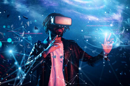 Photo for Boy with VR glasses play with a virtual videogame - Royalty Free Image