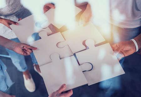 Foto de Teamwork of partners. Concept of integration and startup with puzzle pieces - Imagen libre de derechos