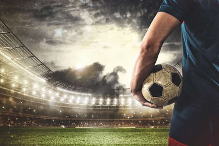 Photo for Soccer player ready to play or kick the ball in his hands at the stadium - Royalty Free Image