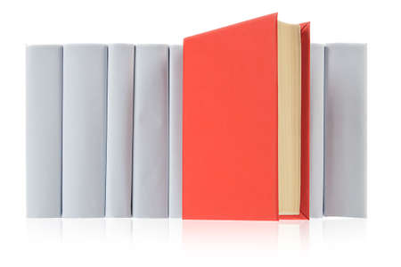 Red book ahead of row from grey books on white