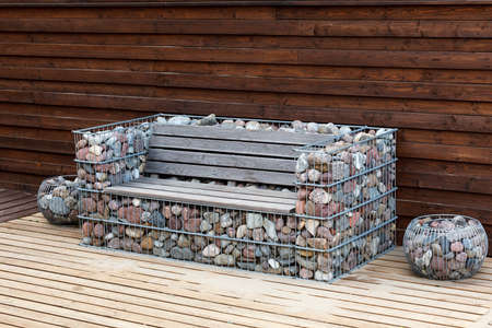 unusual wooden bench with a frame made of cobblestones